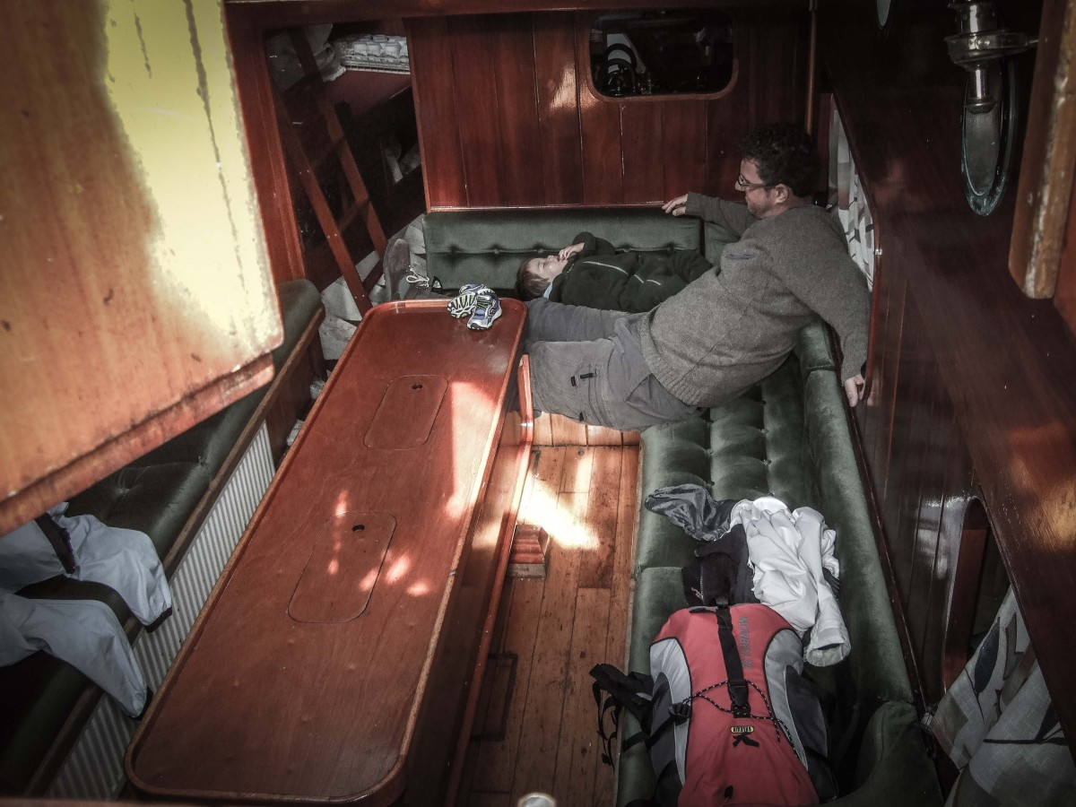 Man watches toddler nap in the hold of a schooner - helping kids find nap time on the road