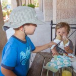 Two boys toasting their ice cream cones in celebration of their hike in Petra.