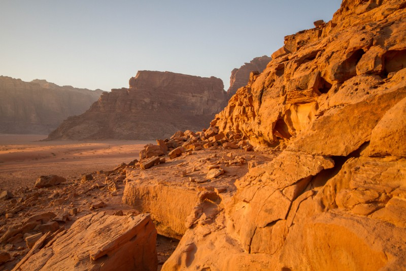 The sun sets over the cliffs of Wadi Rum near the Overnight Luxry Camp in Jordan