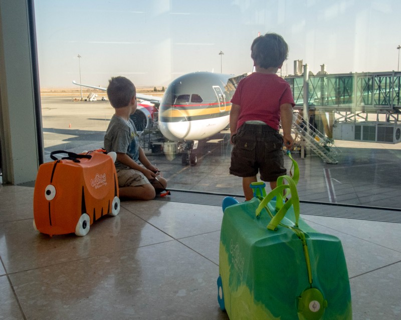 Two boys watch a Royal Jordanian plane from Toronto Pearson Airport