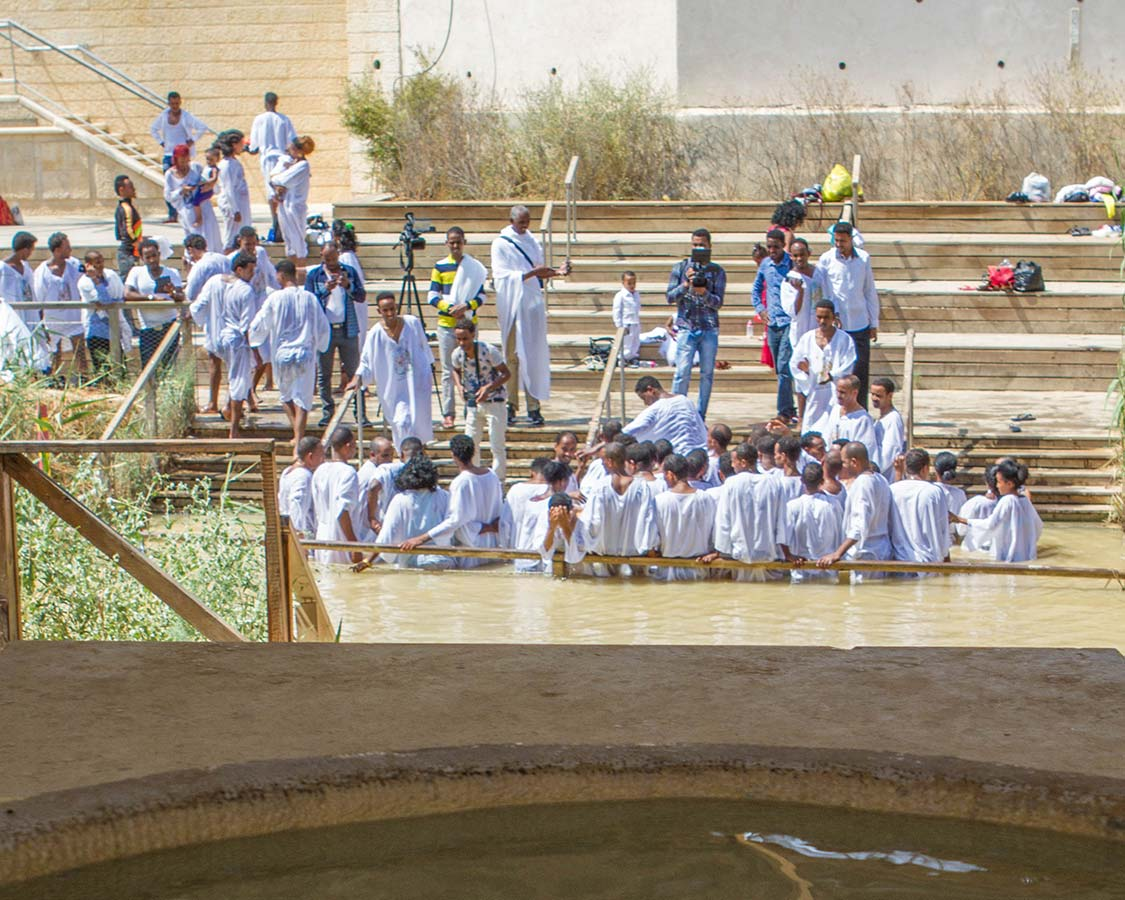 A mass baptism on the Palestine side of the River Jordan at Bethany Beyond the Jordan