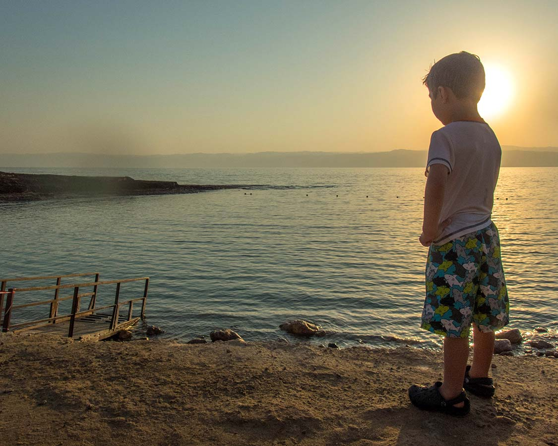 Boy looks at the Dead Sea in Jordan
