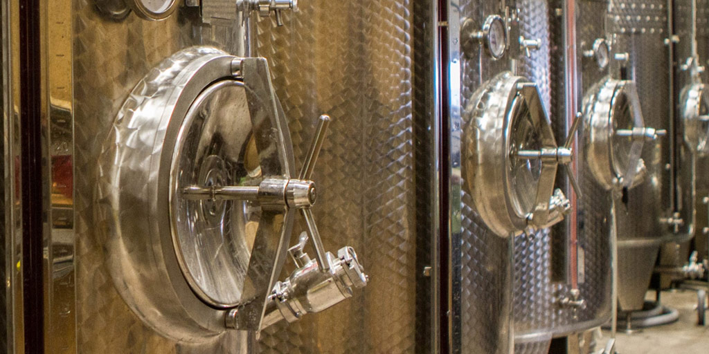 Wine vats lined up in a winery