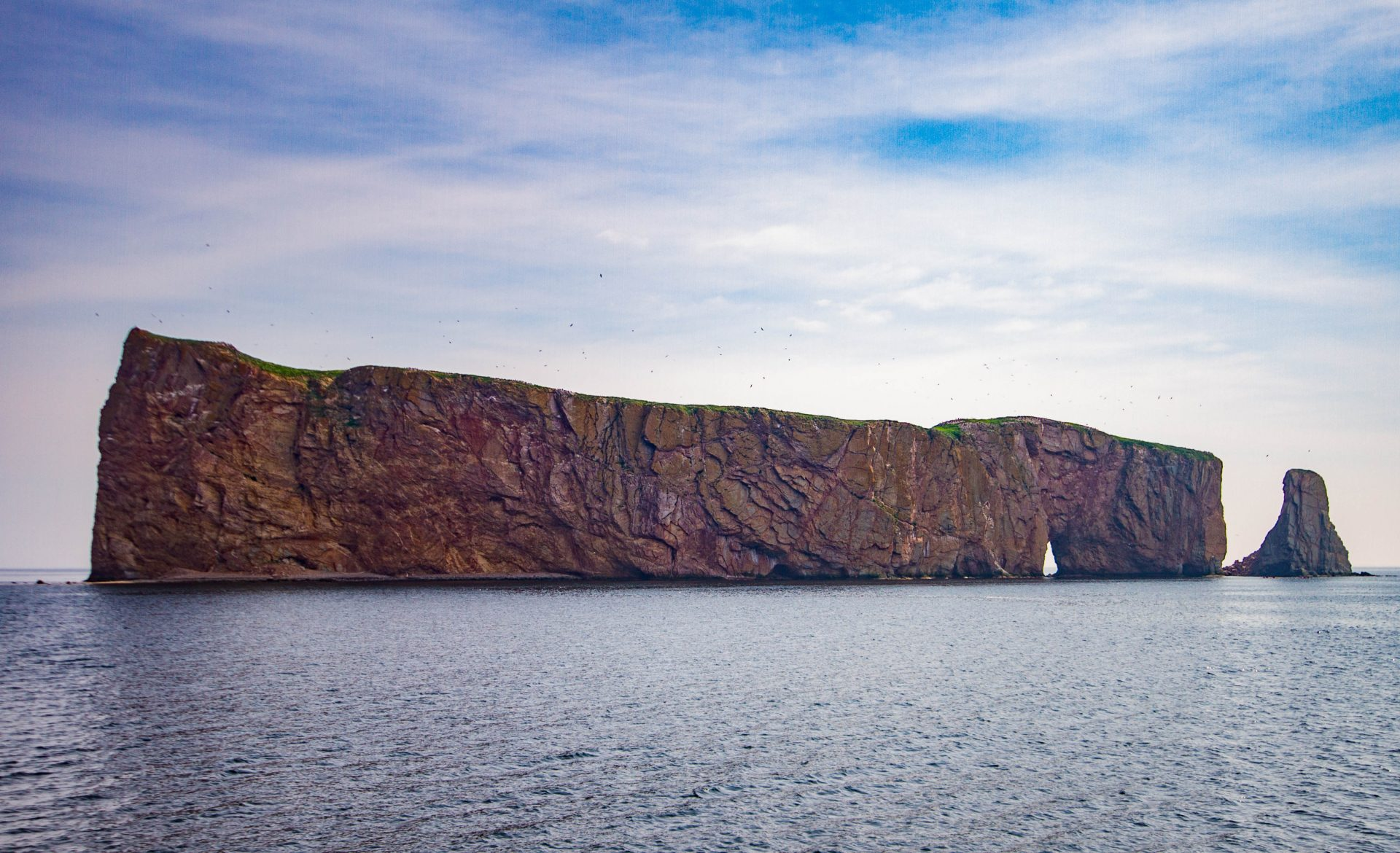 The span of Perce Rock which is located in the National Park of Bonaventure Island and Perce Rock