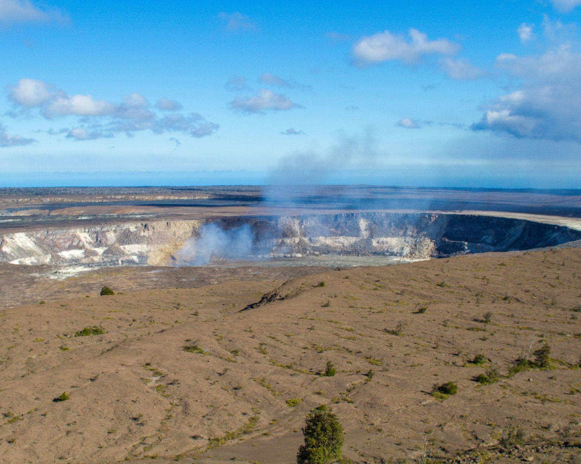 The Halema'uma'u Crater at Hawaii Volcanoes National Park can be seen steaming.
