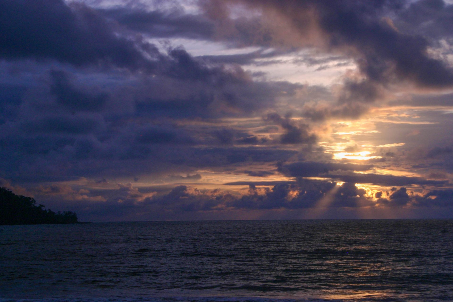A beautiful sunset is reflected in the waters off the coast of Costa Rica - finding paradise in the osa peninsula