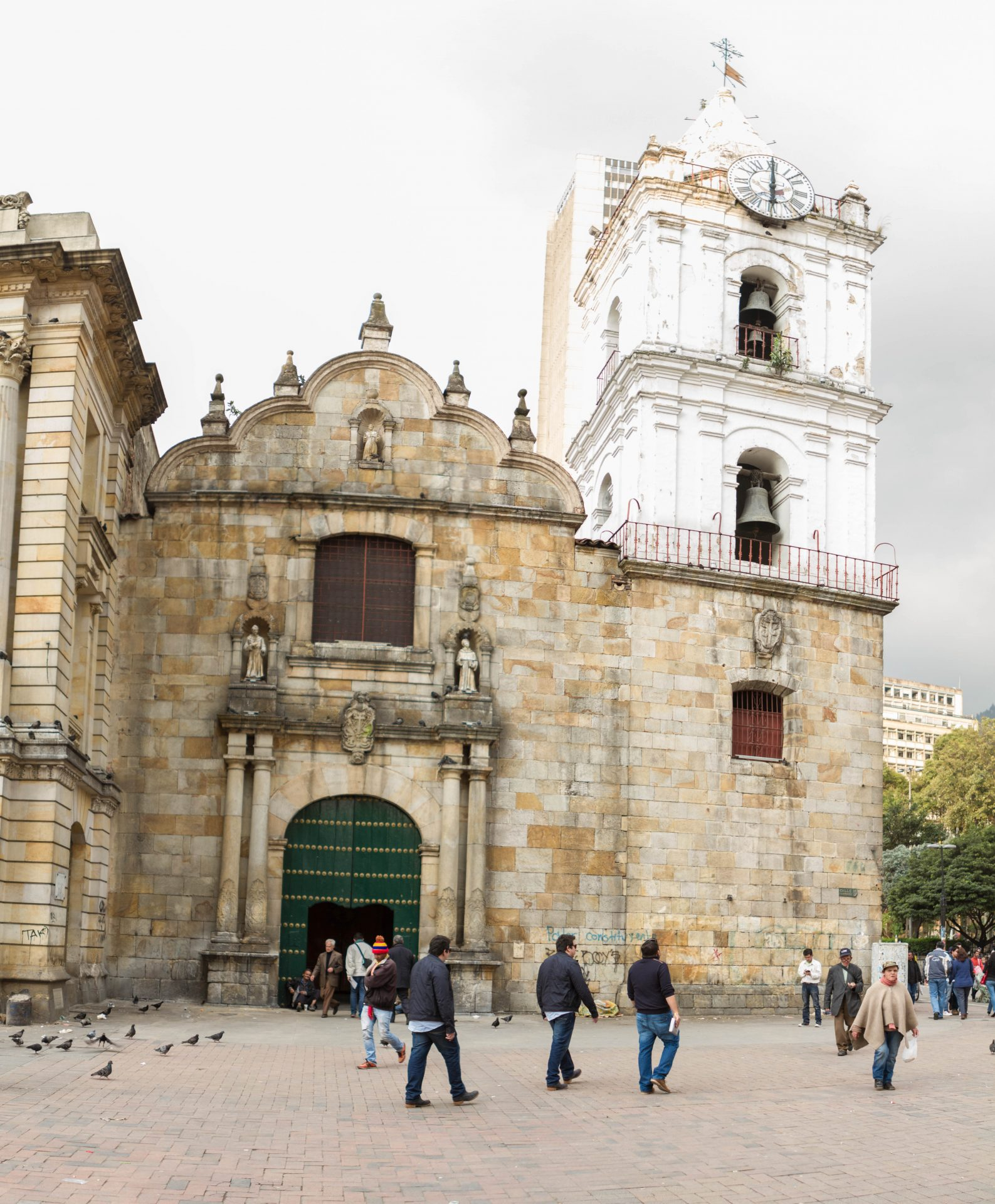Facade of St Francis Church with people in the street in Bogota Colombia.