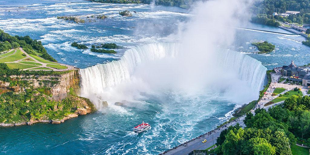 Niagara Falls Horseshoe Falls viewed from above with Hornblower cruise boat - explore niagara falls