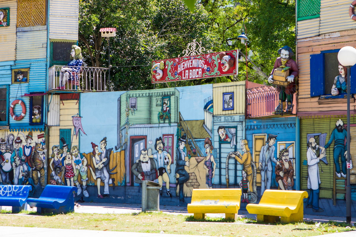 Colorful art welcomes people at entrance of La Boca, one of our Buenos Aires highlights.