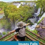 Boy pointing to falls in Iguazu Falls National Park in Argentina.