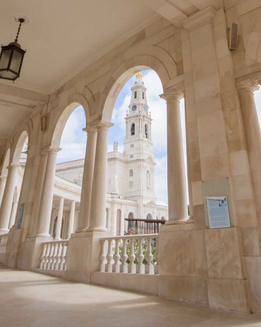 The Shrine of Fatima framed by the arches of the covered walkways