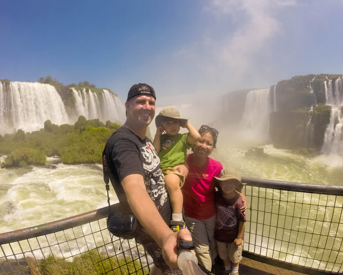 Family take a selfie at the end of the Cataratas Trail in Iguazu Falls Brazil.