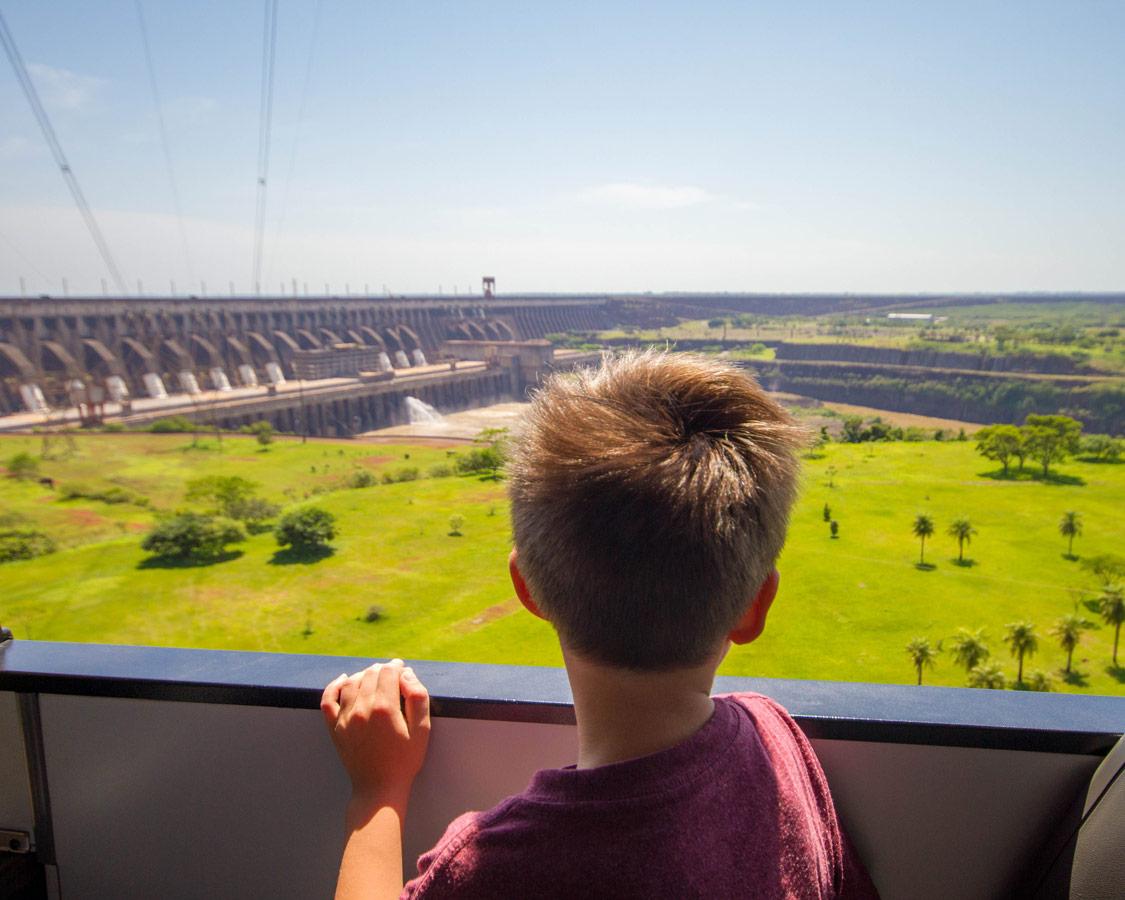 Boy looking in awe at the Itaipu Dam.