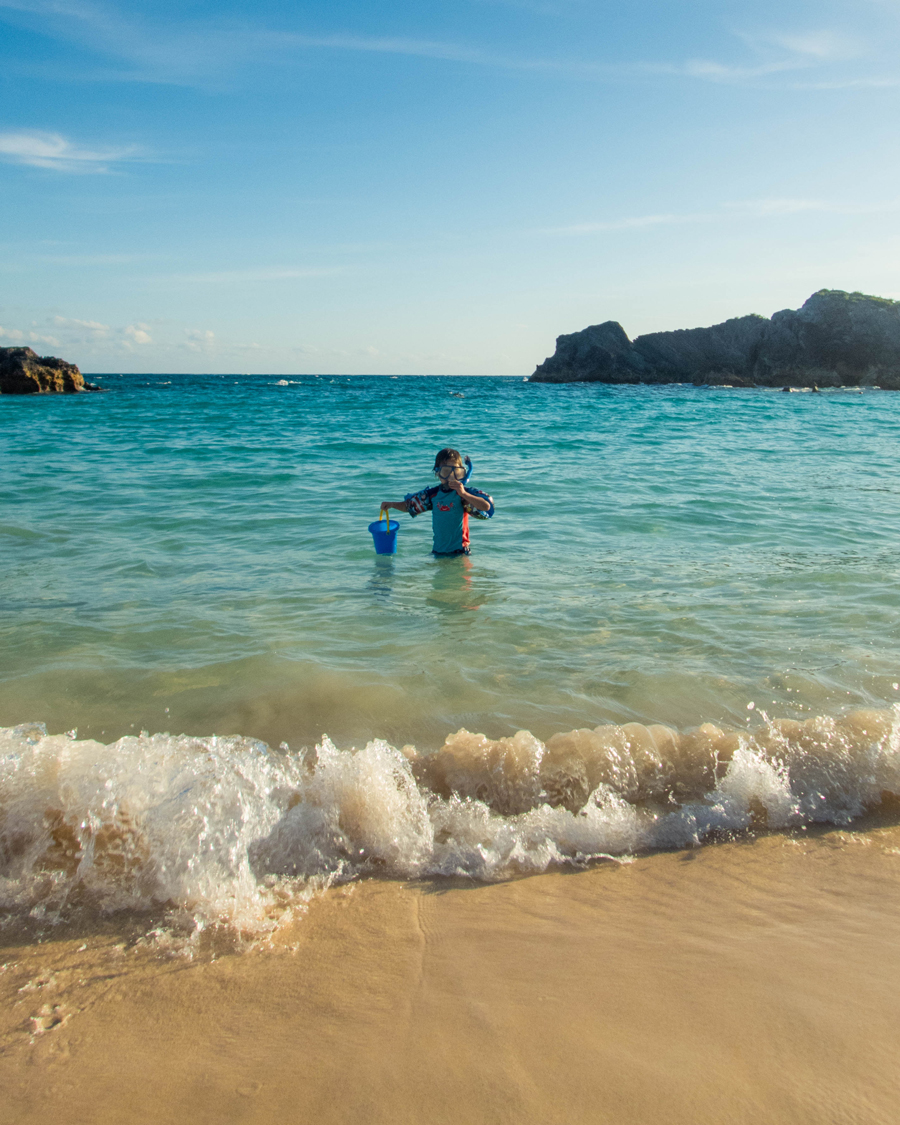 Boy snorkeling in the Atlantic waters off the coast of Bermuda.