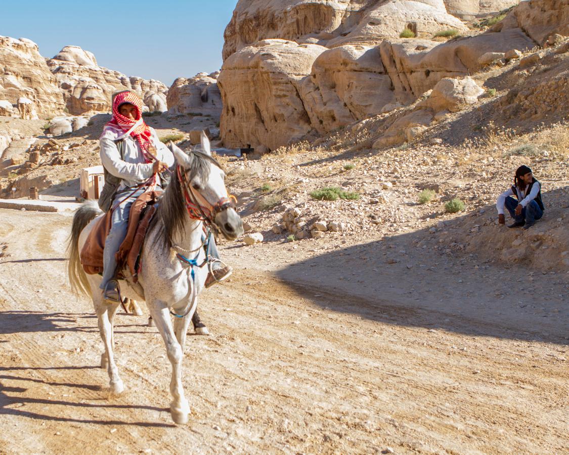 Bedouin horseman riding towards al Siq in Petra Jordan
