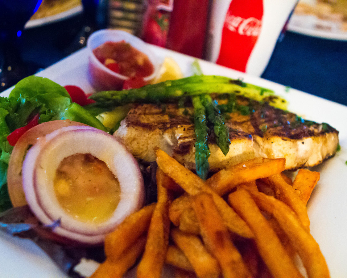 Fresh fish with french fries and salad from Wahoos Bistro and Pub in St. George Bermuda