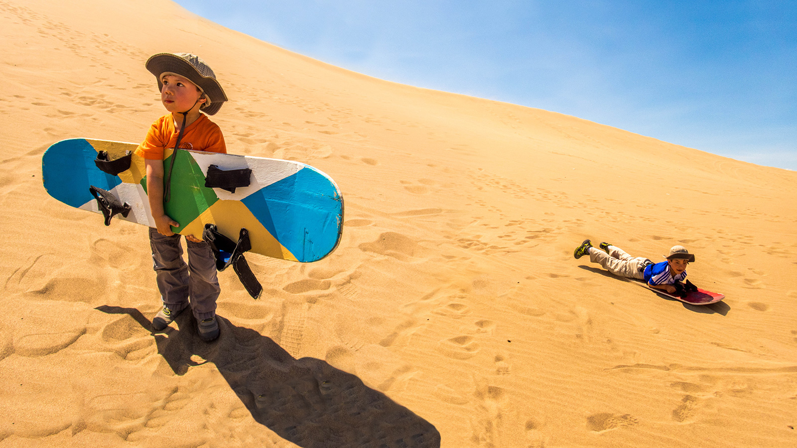 Huacachina is a town made famous by those in search of adrenaline. Check out why we think that riding dune buggies and sandboarding Peru with kids is epic!