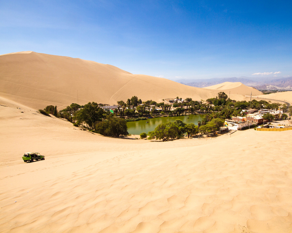 A dune buggy approaches the Huacachina oasis near Ica, Peru