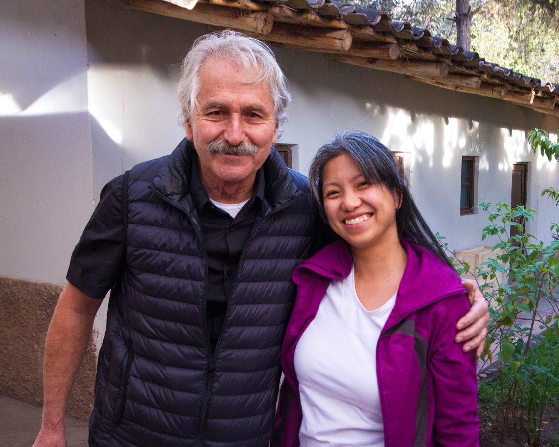 Travel writer Christina Wagar and Pablo Semniario smiling after our ceramics painting for kids workshop at Taller Ceramica in Urubamba Peru