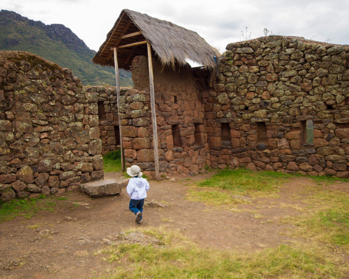 A child walks through the Inca ruins at the Pisac Archaeological Site near Pisac Peru