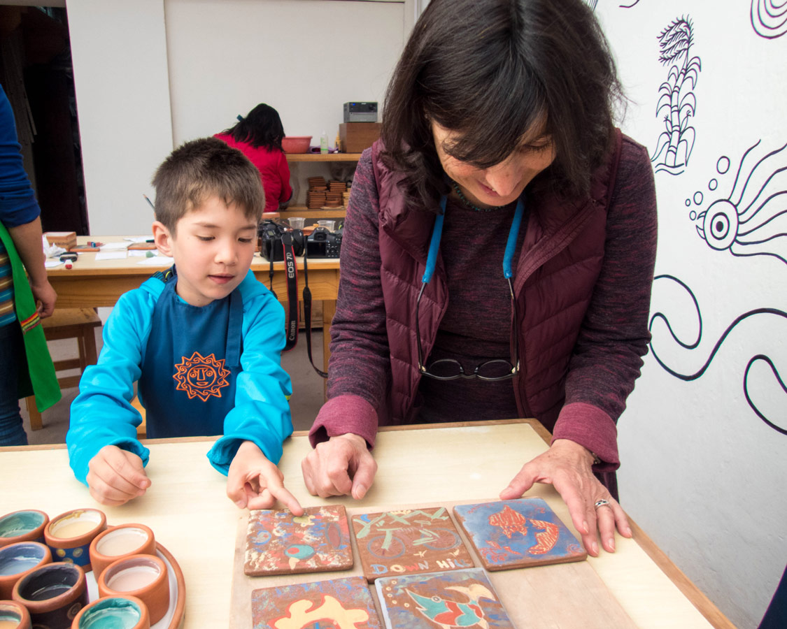 Marilu Behar shows C the finished product- of our Ceramic painting for kids workshop at the Pablo Seminario Taller Ceramica in Urubamba Peru