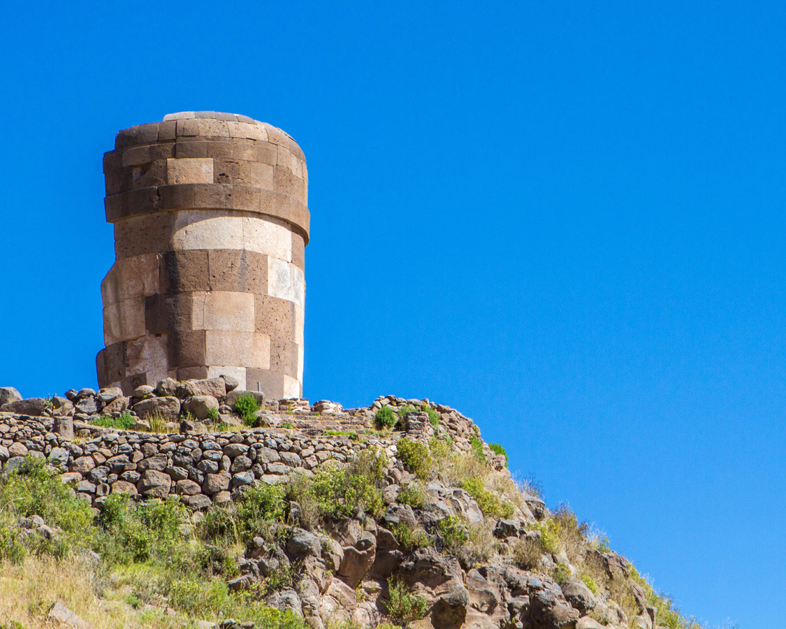 Chullpas or pre-incan burial towers in Sillustani Peru on our way to see the Andean Condors in Colca Canyon with Kids