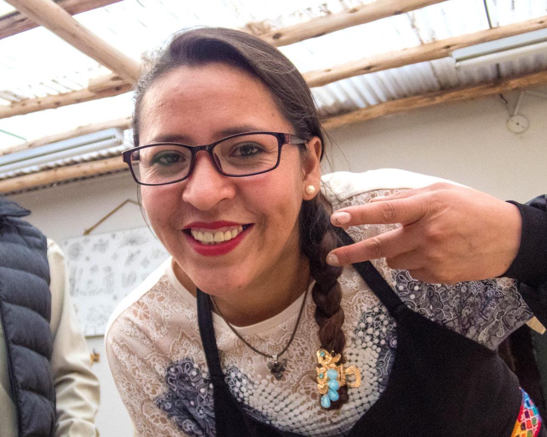 A staff member of Taller Ceramica and Pablo Seminario at a ceramics painting for kids workshop in Urubamba Peru