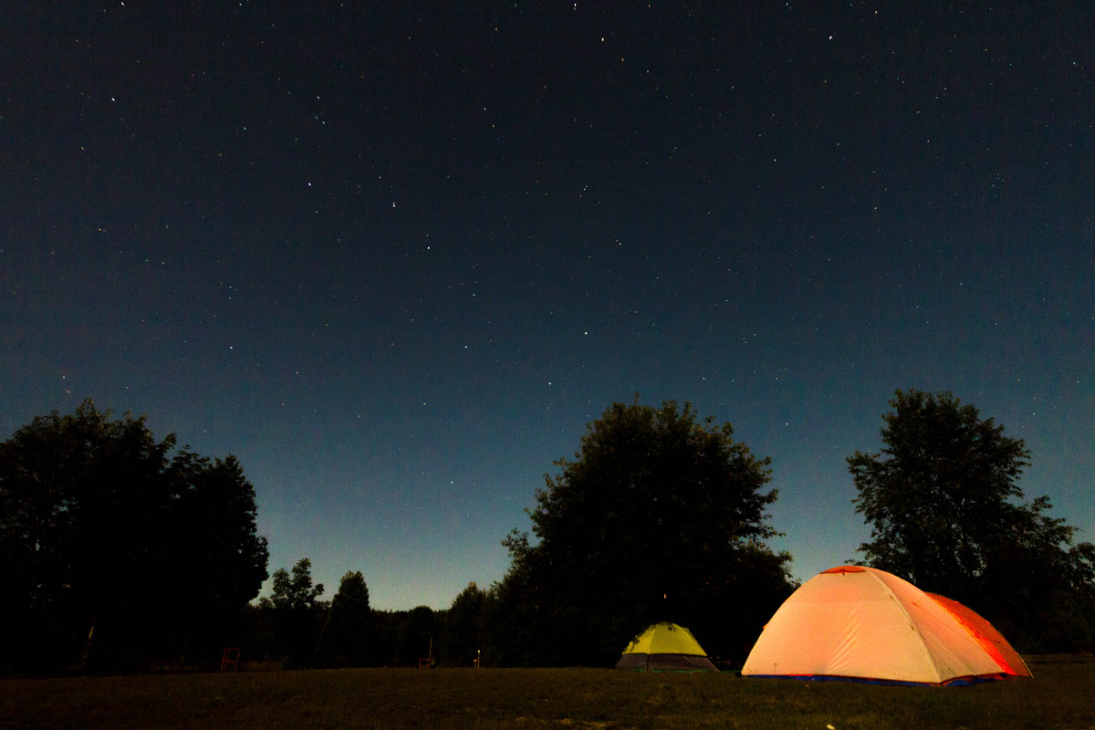Camping tents at Gordons Park Dark Sky Preserve on Manitoulin Island. A visit to Gordons Park is one of the best things to do on Manitoulin Island