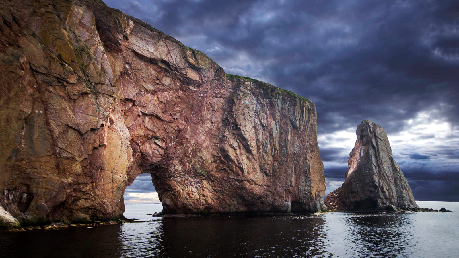 Perce Rock on the Gaspe peninsula stands dramatically out from the gulf of St. Lawrence