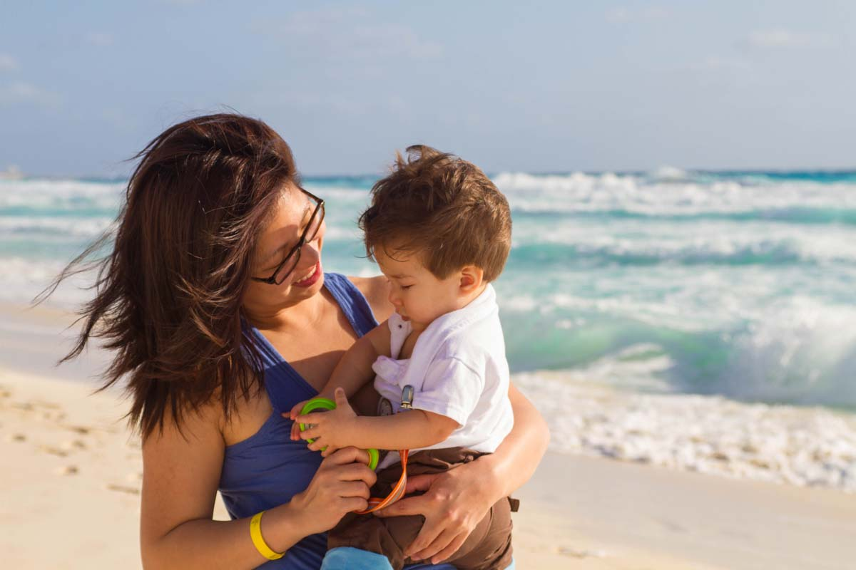 Christina Wagar and C on the beach in Tulum Mexico with kids