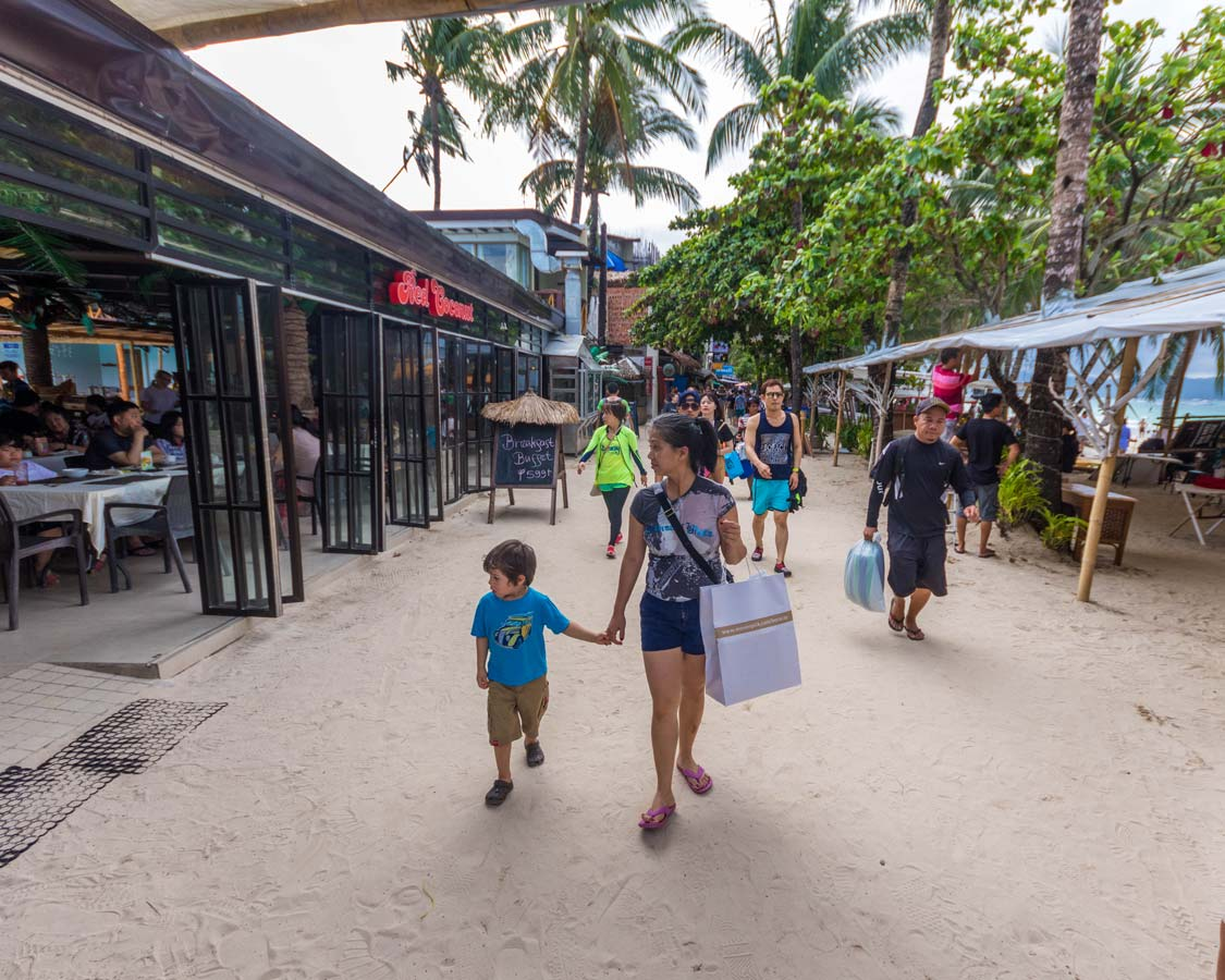 Shopping-atA woman and young son shop at DMall in Boracay Philippines Station 2