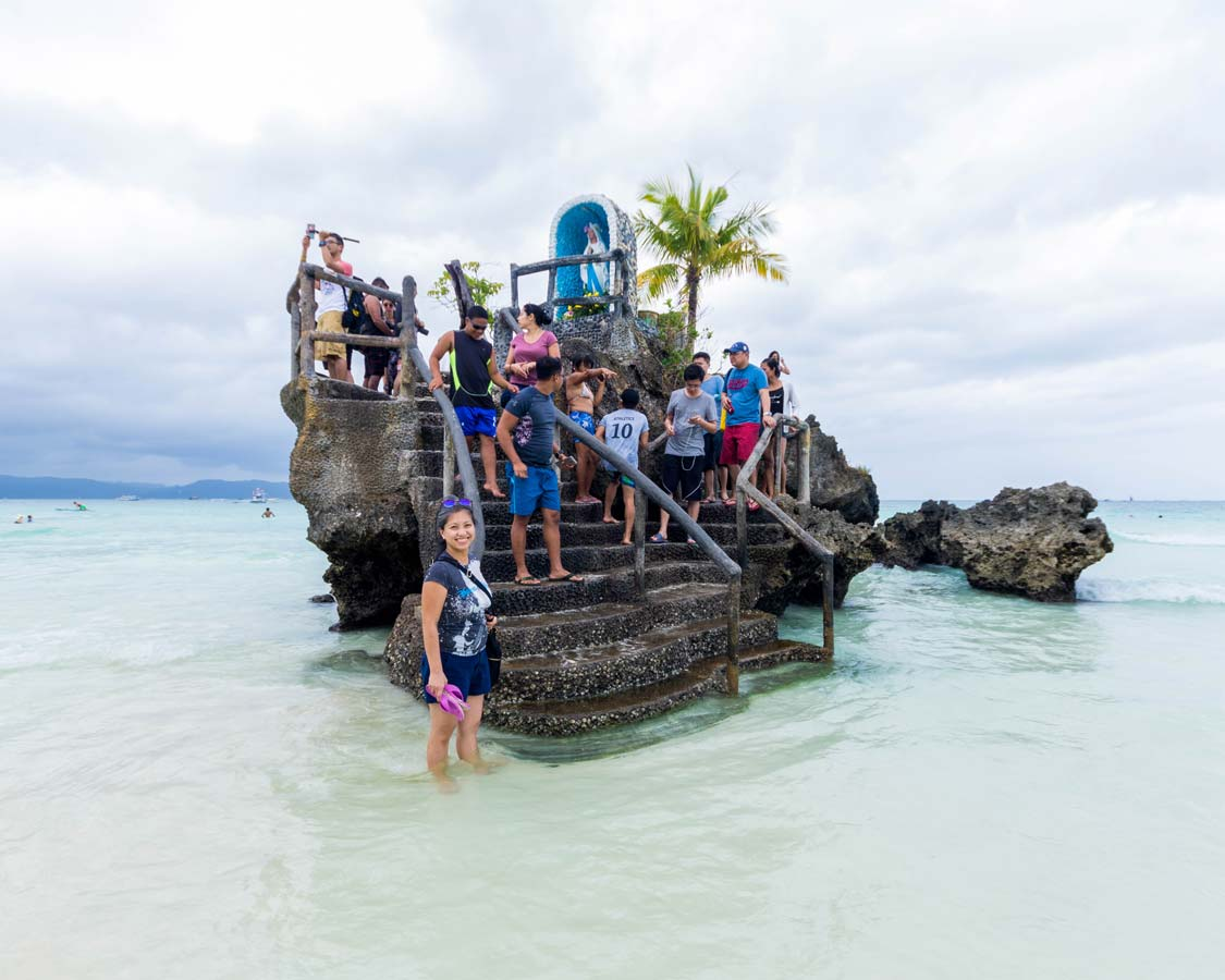 Willy's Rock in Boracay Philippines with typical crowds