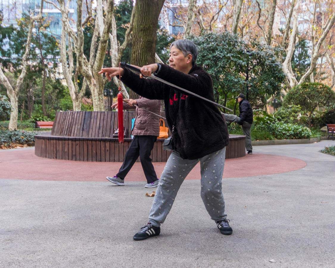 Women with swords perform excercises at Xiangyang Park in Shanghai China