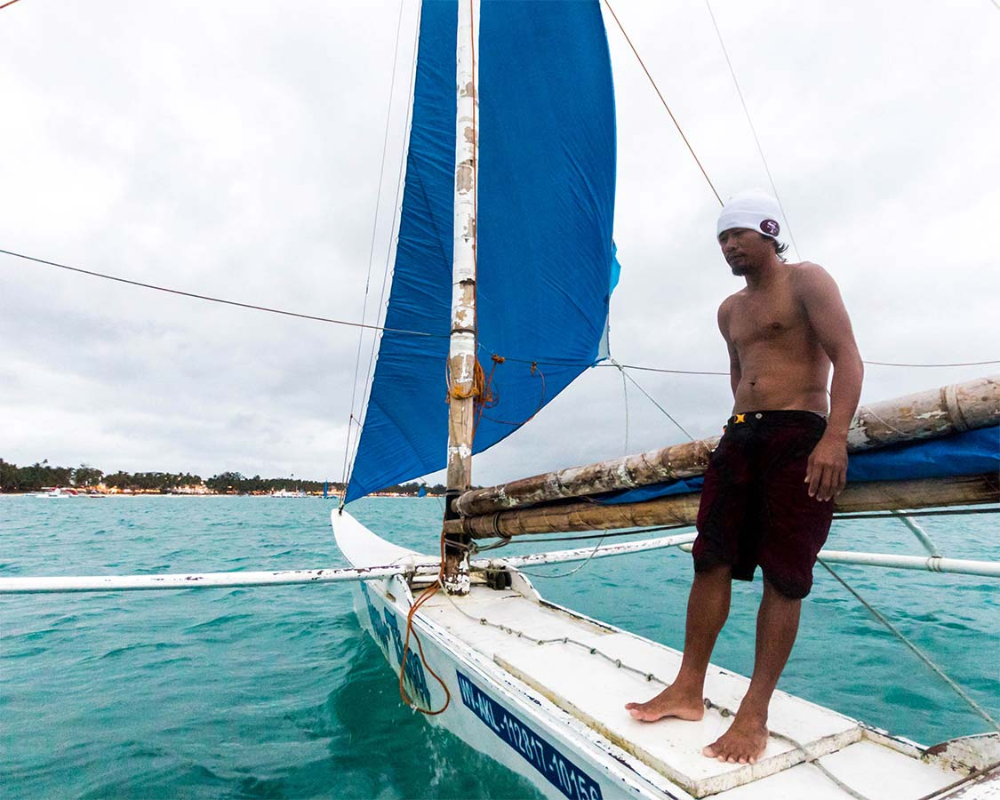 A paraw boat captain sailing in Boracay Philippines