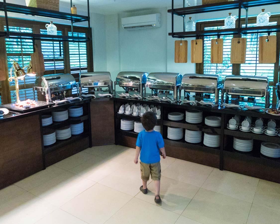 boy at a breakfast buffet at the Movenpick Boracay hotel