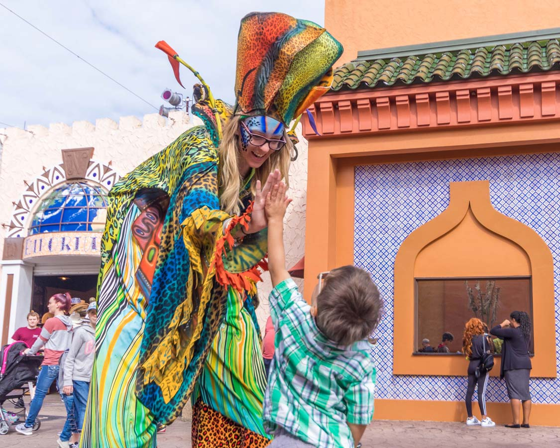 A young boy greets a performer at Busch Gardens Tampa Bay Florida with kids
