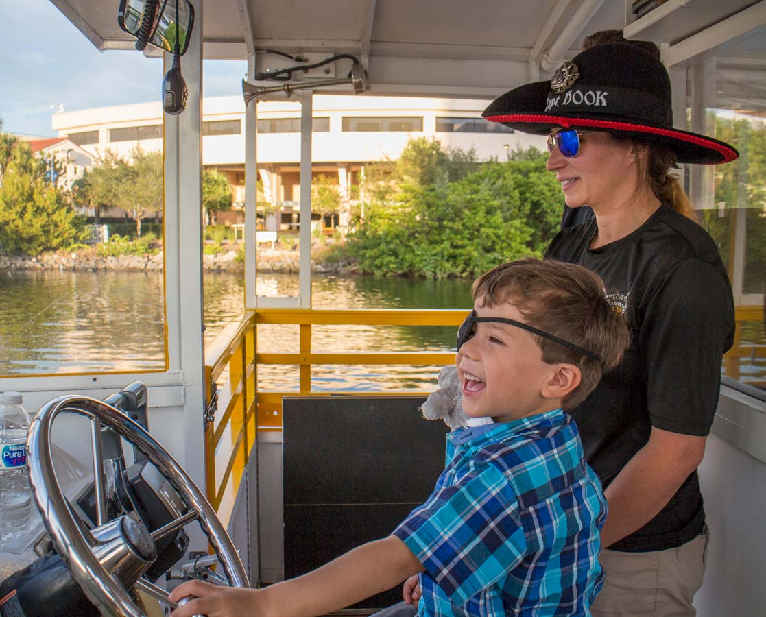 A young boy laughs on the Tampa Pirate Water Taxi along the Tampa Riverwalk in Florida