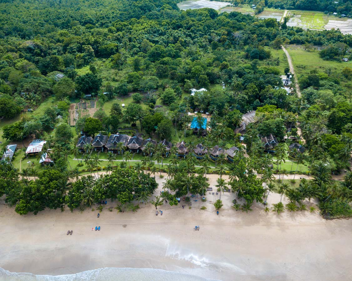 Daluyon Beach and Mountain Resort in Saban, Puerto Princesa seen from a drone over the water