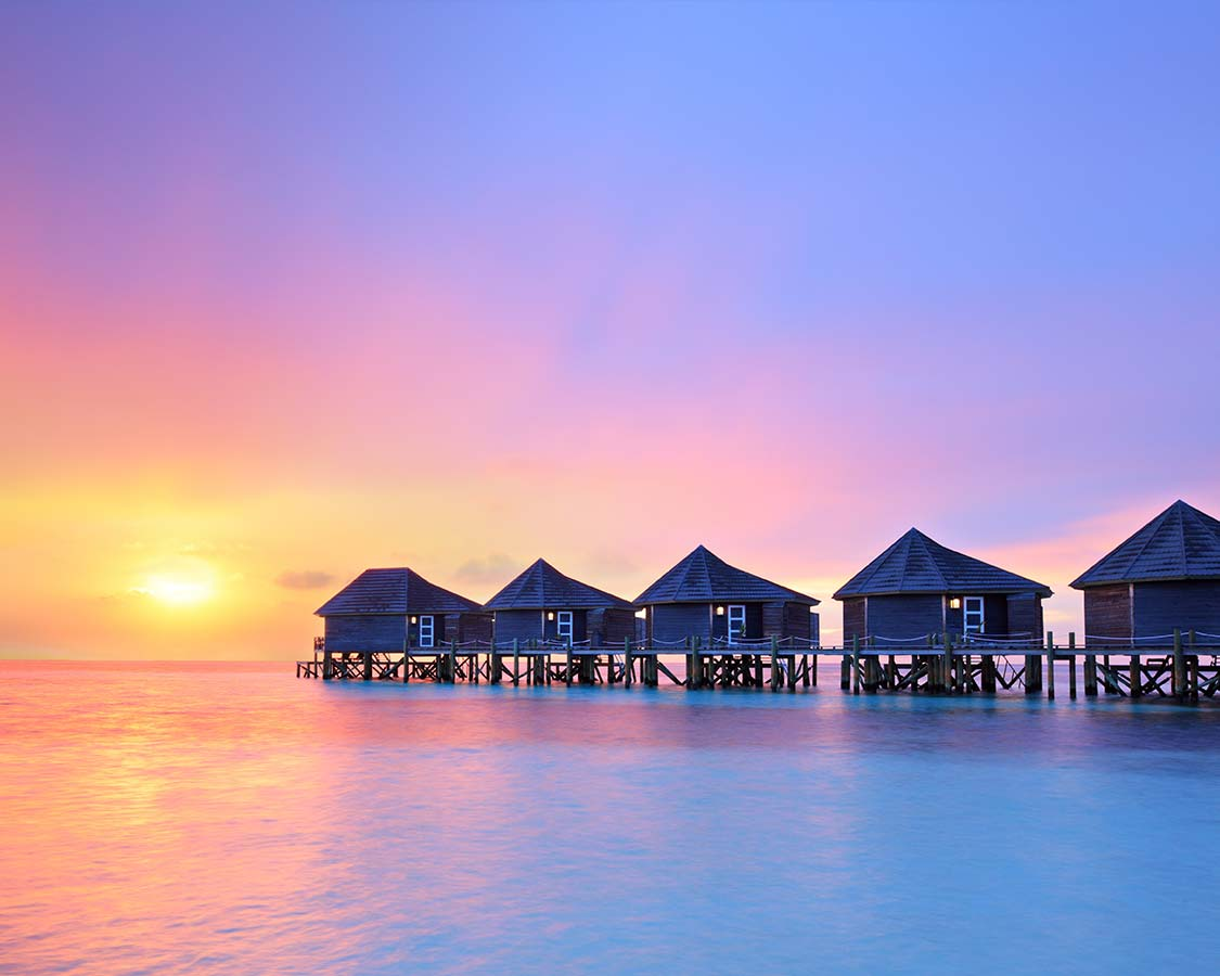 Overwater Bungalows in Maldive with kids s at sunset