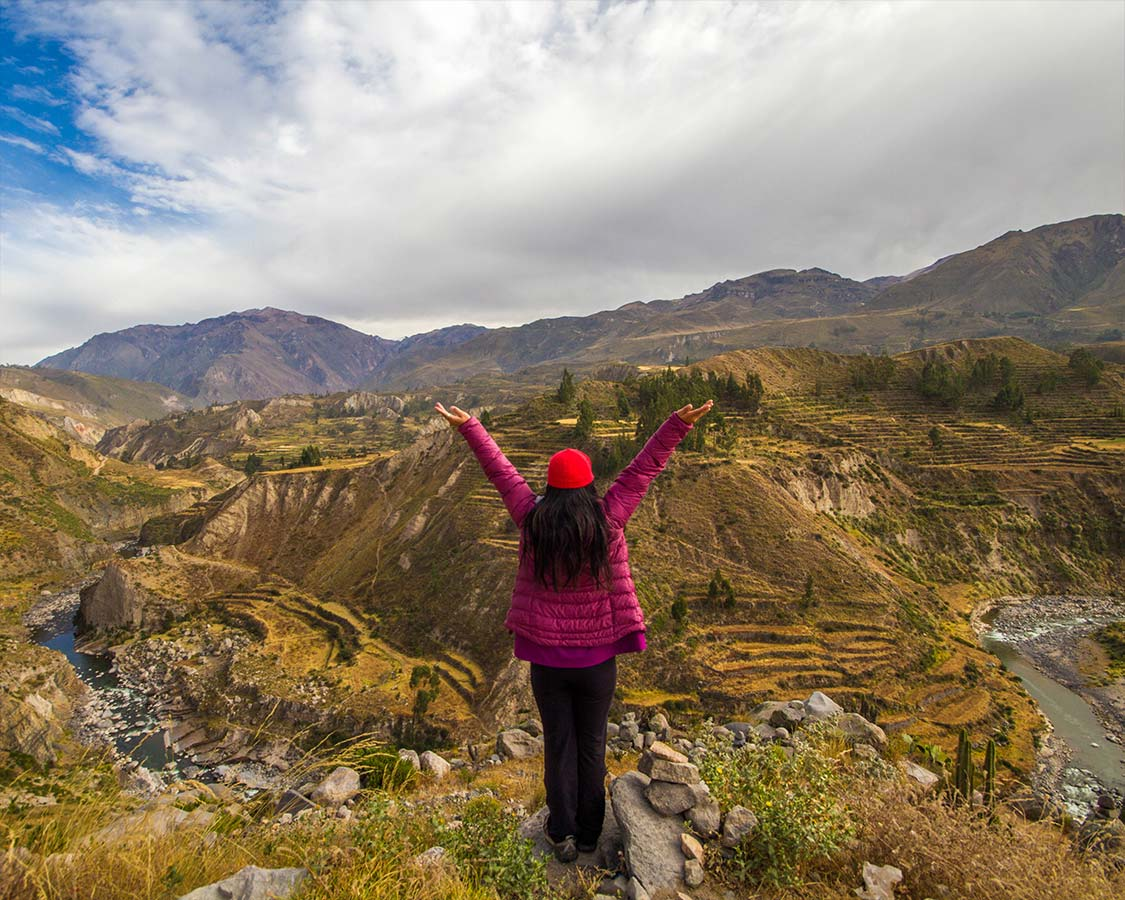 Woman posing in Colca Canyon Peru