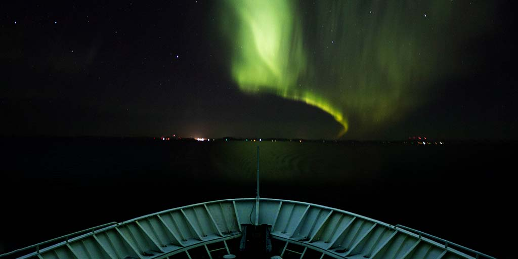 A Norway coastal cruise is one of the best ways to get a view of the Northern Lights. But how does a Hurtigruten Northern Lights Cruise stack up against other options out there. We share our experiences on a Hurtigruten coastal cruise to help you decide if its right for you!