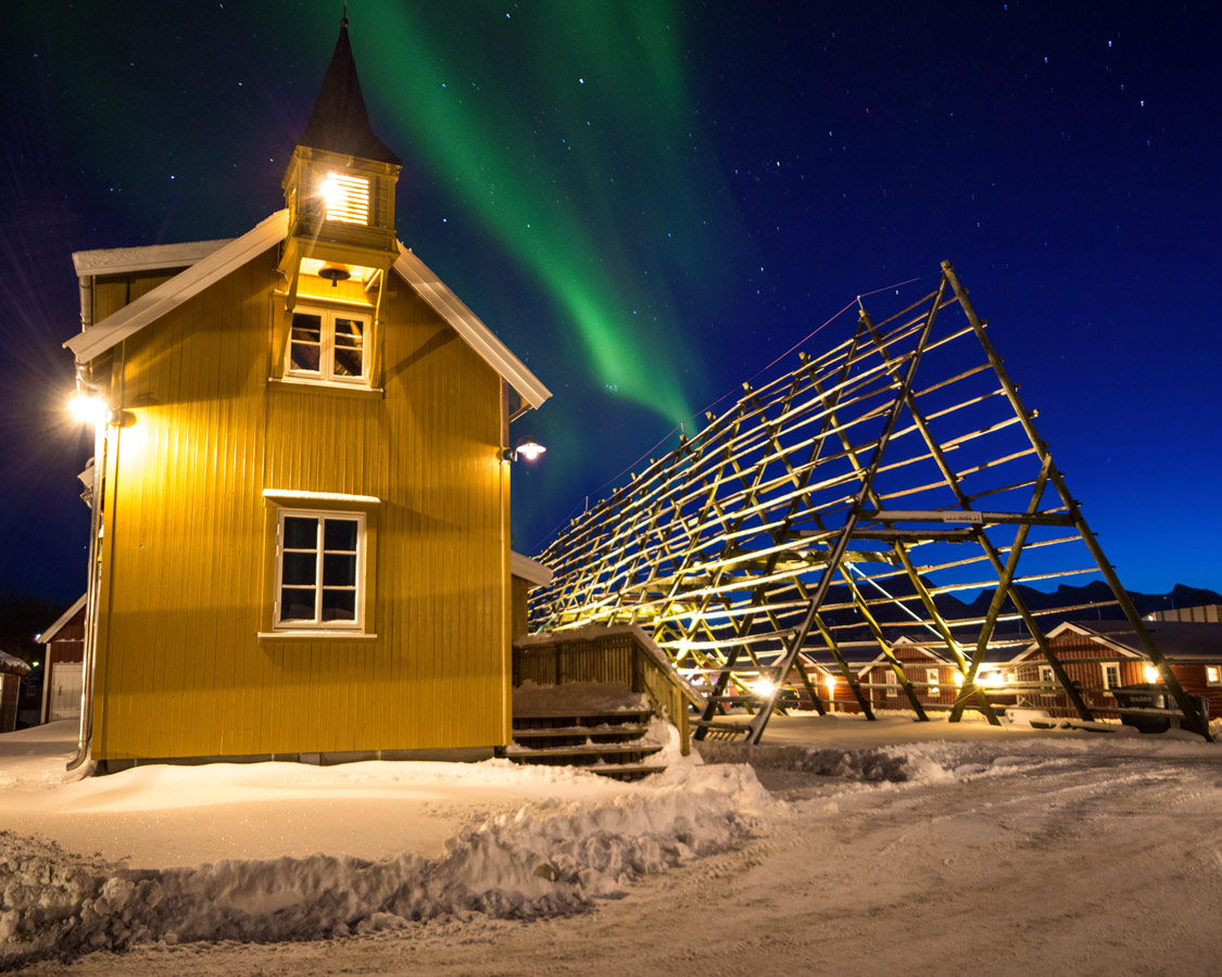 Northern Lights with Chuch and Fish Racks in Svolvaer Norway Coastal Cruise