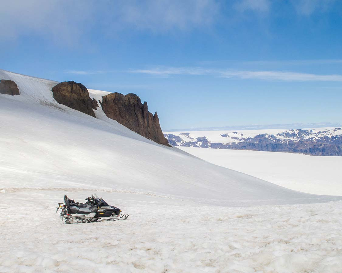 Iceland for families Snowmobiling across a glacier