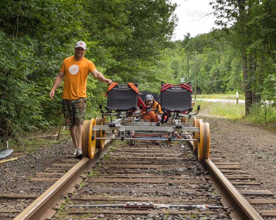 Revolution Rail Co staff shuffling Rail Bike