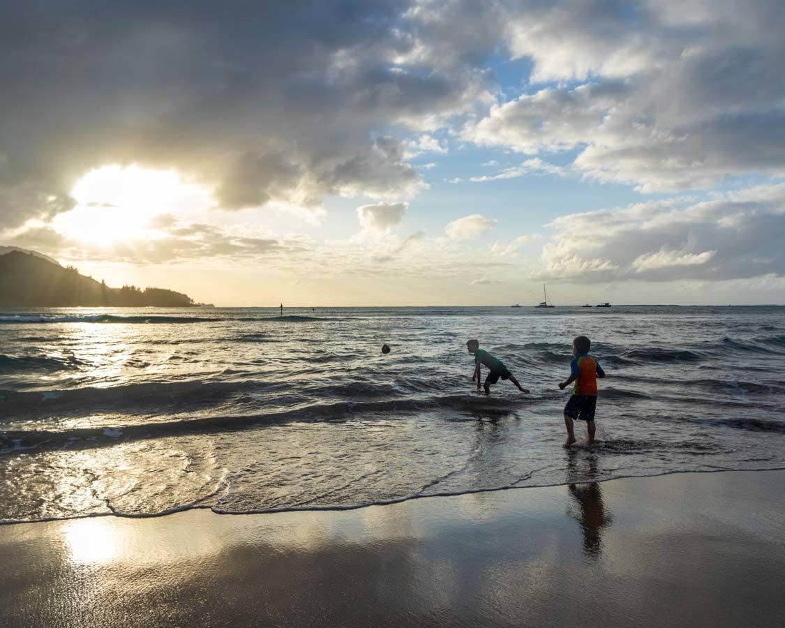 Sunset swimming at Hanalei beach in Kauai for kids