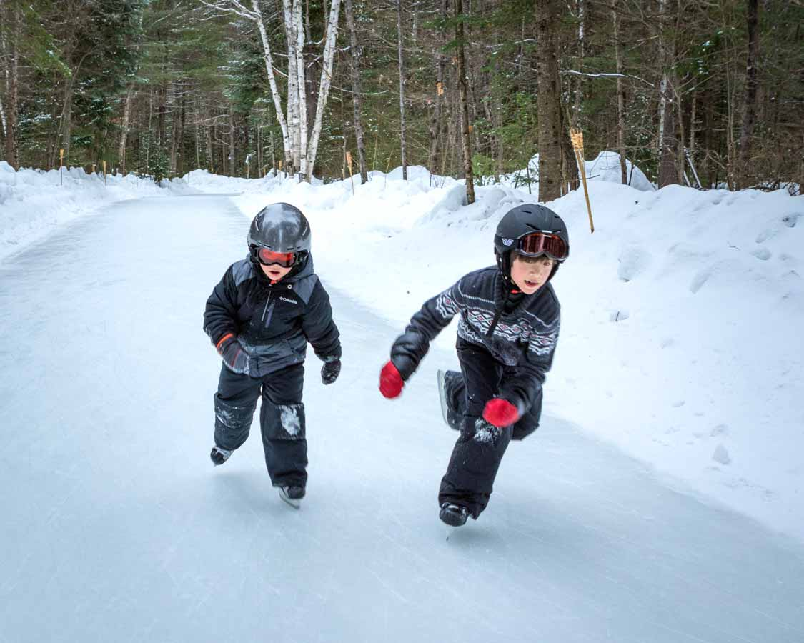 Two boys skating during winter at MacGregor Point Provincial Park