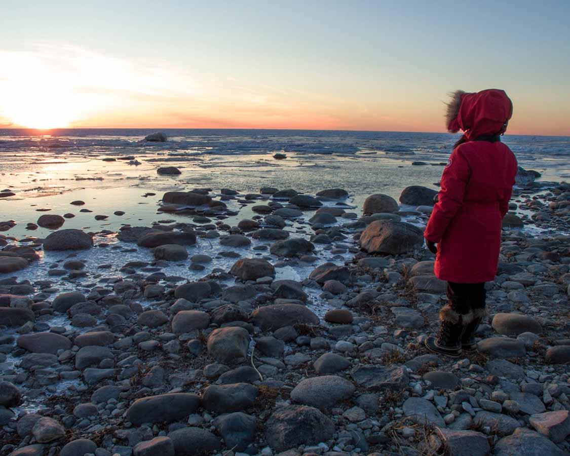 Woman watching sunset at MacGregor Point Ontario