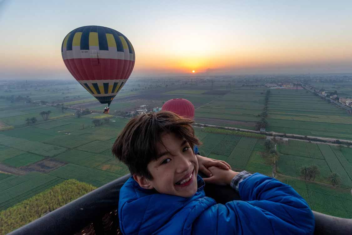 Child in a Luxor hot air balloon at sunrise