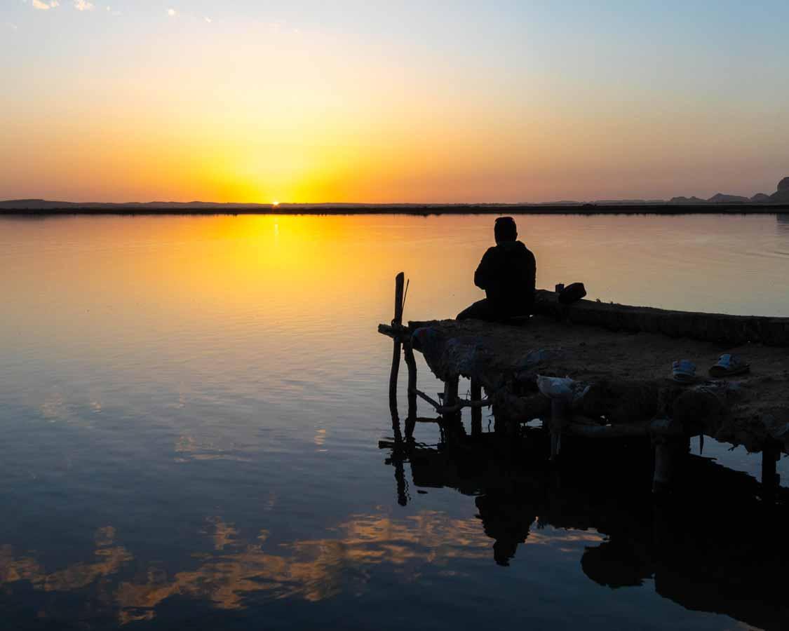Desert sunset on Fatnas Isand Things to do in Siwa Egypt