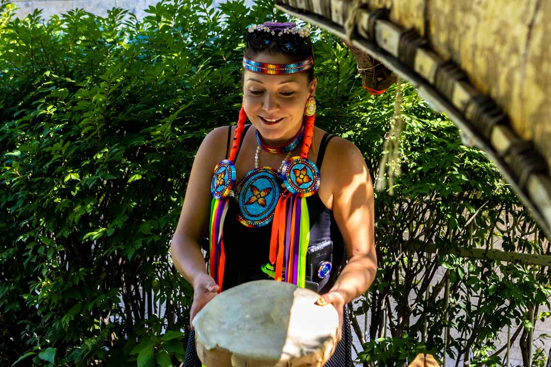 Marie Seline Shows Off A First Nations Drum At Indigenous Experiences Ottawa